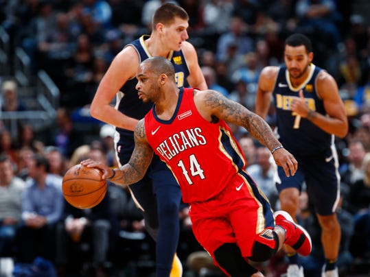 FILE- In this Dec. 15, 2017, file photo, New Orleans Pelicans guard Jameer Nelson, front, picks up the ball in front of Denver Nuggets center Nikola Jokic, center, of Serbia, and forward Trey Lyles in the first half of an NBA basketball game in Denver.  A person familiar with the decision says the New Orleans Pelicans have acquired forward Nikola Mirotic and a second-round draft pick from the Chicago Bulls for center Omer Asik, guards Jameer Nelson and Tony Allen, and a future first-round pick. The person spoke to The Associated Press on condition of anonymity Thursday, Feb. 1, 2018,  because neither team has announced the trade. (AP Photo/David Zalubowski, File)