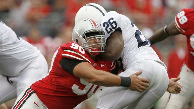 Penn State running back Tony Hunt gets tackled by Ohio State Buckeyes defensive tackle Quinn Pitcock for a loss at Ohio Stadium on September 23, 2006.