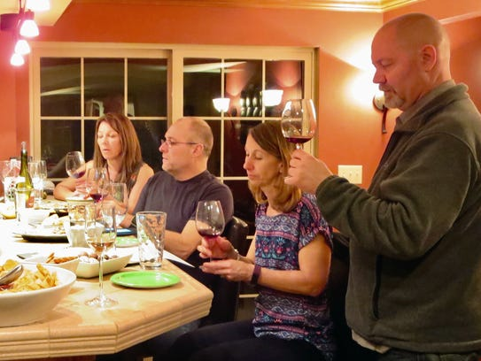 Scrutinizing a red wine at their Waukesha wine club