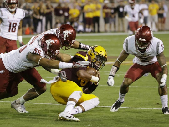Arizona State quarterback Dillon Sterling-Cole is tackled