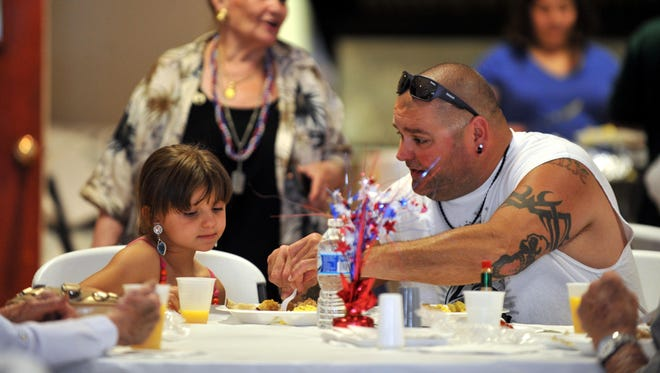 Gianna Donoflio, 6, of Vineland, gets help cutting her breakfast from dad Vince Donoflio, during Father's Day breakfast at North Italy Hall in Vineland.