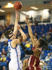 Delaware forward Jacob Cushing lifts a shot over College