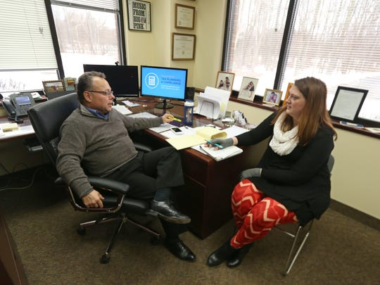 Kenneth Pink, Partner, meets with Lindsay Thaine, director, in his office at the Bonadio Group in Pittsford Friday, Feb. 10, 2017.