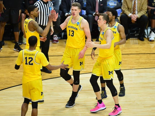 Michigan forward Moritz Wagner, middle, could be a
