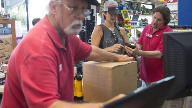 Dozens of patrons shopped for Hurricane Irma supplies in preparation for the storm onSept. 4, 2017 at Peter's Hardware Center in Palm City.