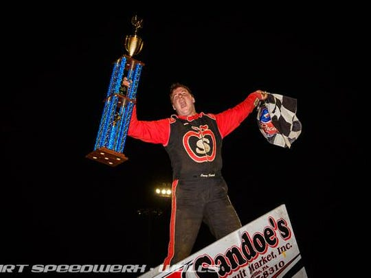 Danny Dietrich, seen here celebrating a win in a file photo, is the hottest driver on the local racing circuit entering the 2019 Pennsylvania Sprint Car Speedweek. Dietrich has nine wins this season.
