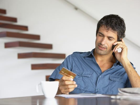 man-with-credit-card-on-phone2_large.jpg