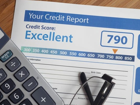 credit-report-credit-score-with-calculator-getty_large.jpg