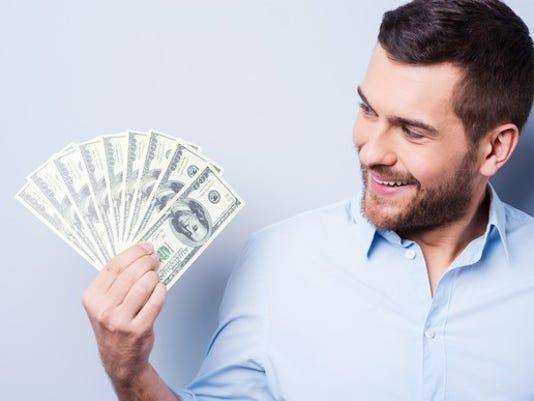 man-holding-money_large.jpg