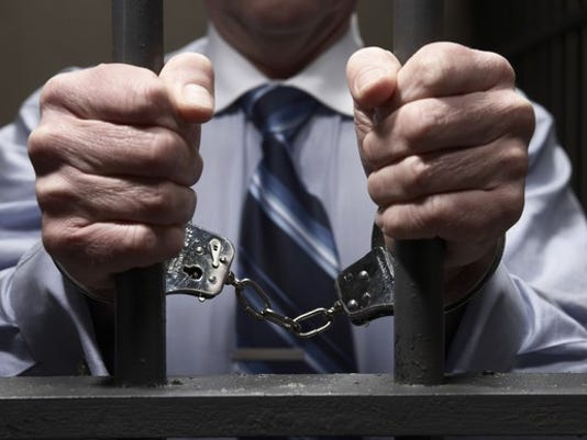 prison-handcuffs-handcuffed-jail_large.jpg