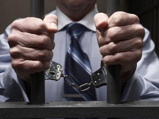 prison-handcuffs-handcuffed-jail_large.jpg