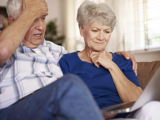 Boomer Couple Look At Computer