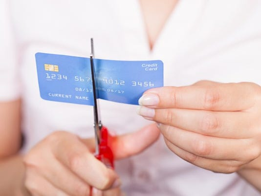cut-credit-card-debt-credit-score-collection-getty_large.jpg