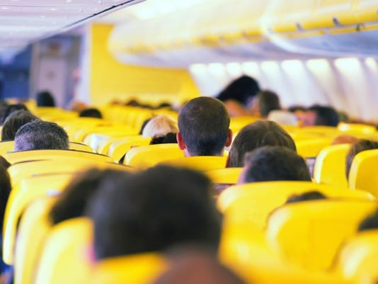 people-inside-crowded-airplane_large.jpg