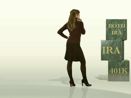 businesswomen-looking-at-roth-ira-401k-building-blocks-getty_large.jpg