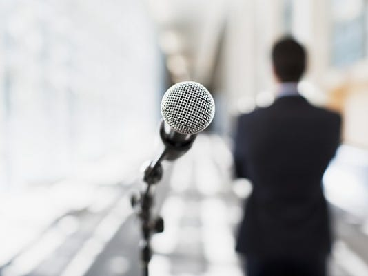 man-in-front-of-mic-gettyimages-112156291_large.jpg