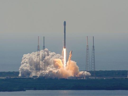 Falcon 9 rocket lifting off