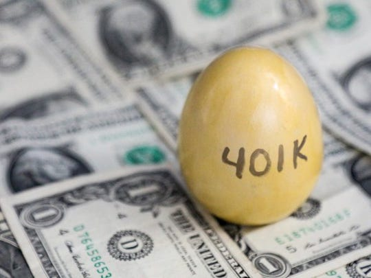 A gold 401(k) egg on top of a pile of cash, representing the value of a 401(k) nest egg for employees.