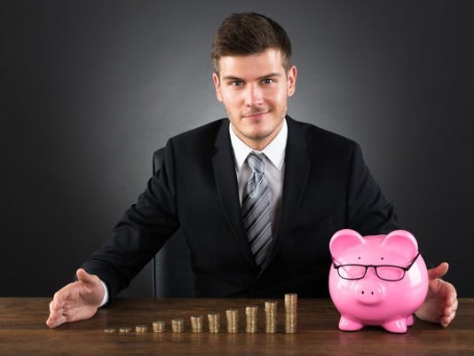 investor-businessman-with-money-and-piggy-bank_large.jpg