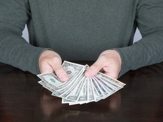person-counting-money_gettyimages-672973584_large.jpg