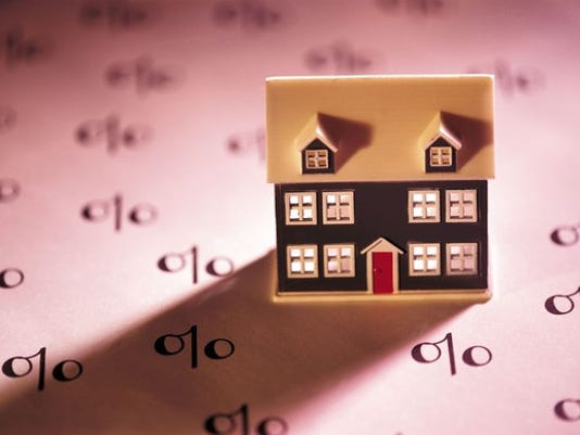 toy-house-on-paper-with-percentage-symbols-mortgage-interest-rate_large.jpg
