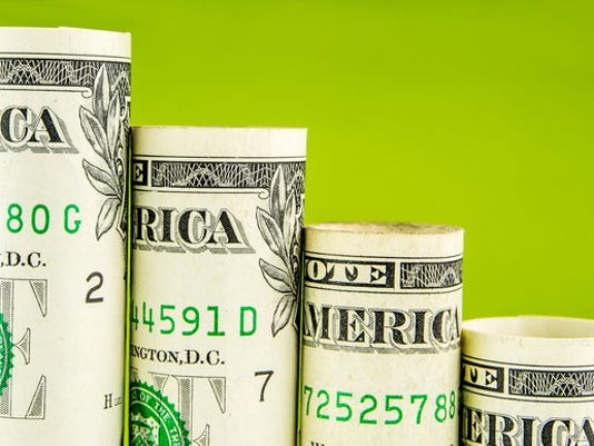 rolled-up-dollar-bills_gettyimages-504073178_large.jpg