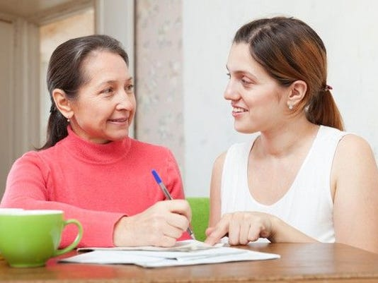 mother-and-daughter-looking-at-loan-documents_gettyimages-186134541_large.jpg