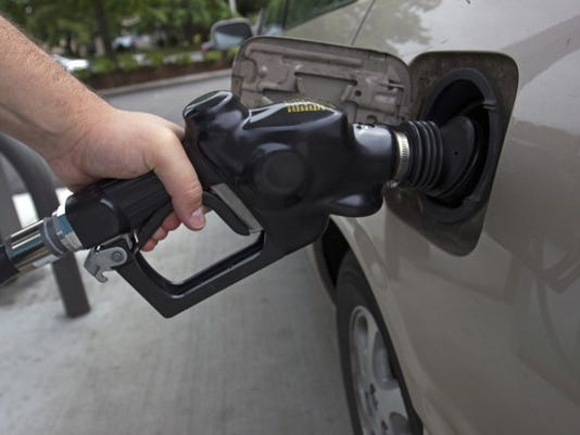 pumping-gas-fuel-costs-inflation-energy-getty_large.jpg