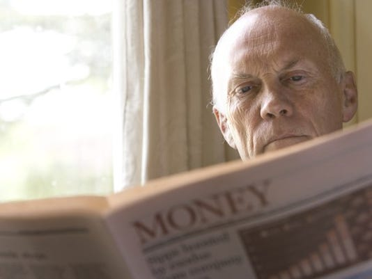 senior-reading-financial-news-investing-getty_large.jpg
