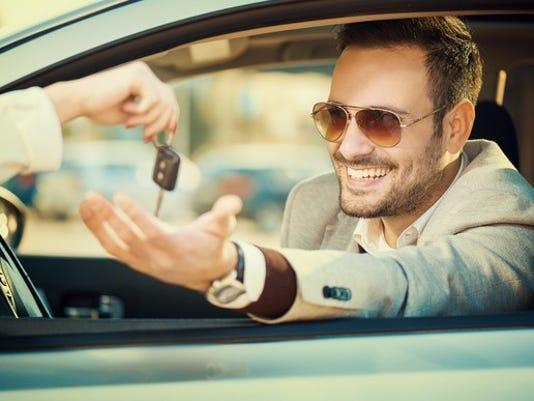 man-taking-car-key-auto-loan-lease_large.jpg