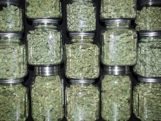 Jars of cannabis stacked on each other