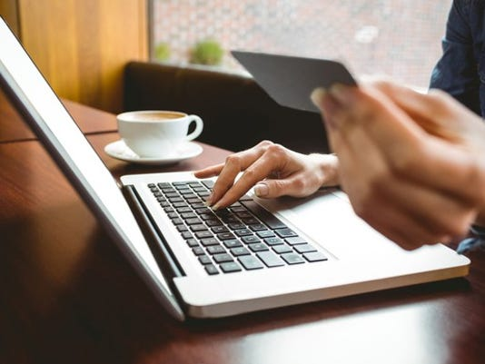 woman-shopping-online-on-laptop-with-credit-card-1_large.jpg