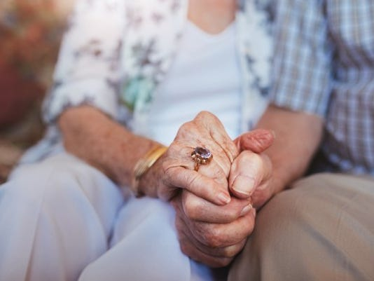 senior-elderly-couple-holding-hands_large.jpg