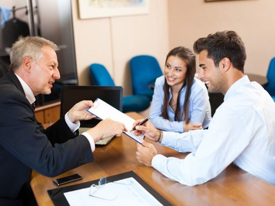 Young couple refinancing a mortgage