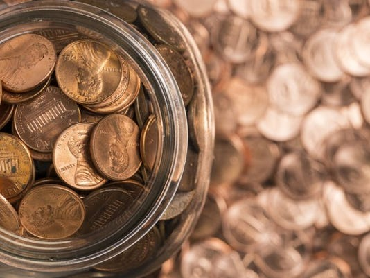 a-jar-of-pennies-surrounded-by-pennies_large.jpg