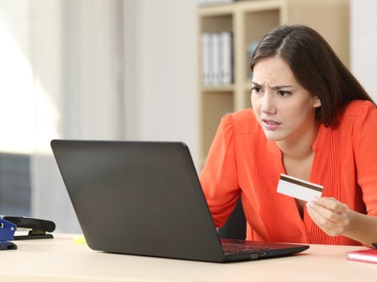 Woman having trouble online with credit card