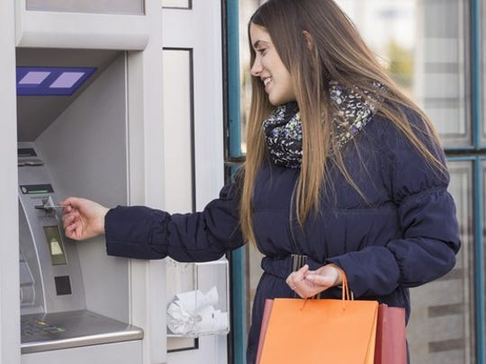 Woman using an ATM