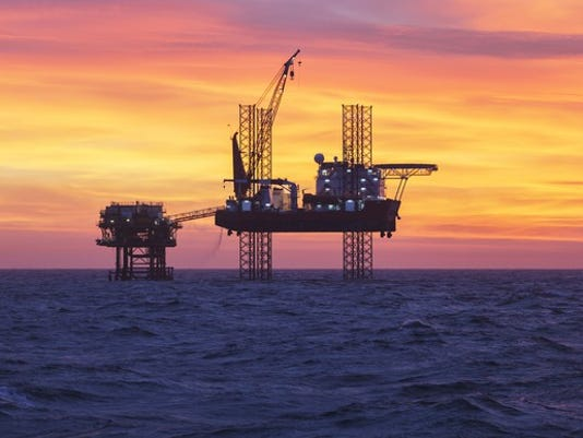 getty-oil-rig-at-sunset_large.jpg