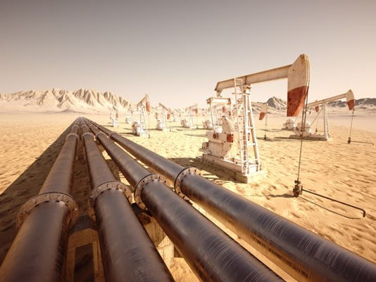 getty-oil-pumps-and-pipes-in-desert_large.jpg