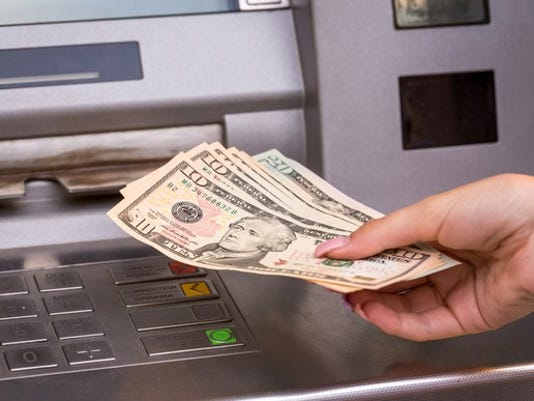 withdrawing-cash-from-atm_gettyimages-576744124_large.jpg