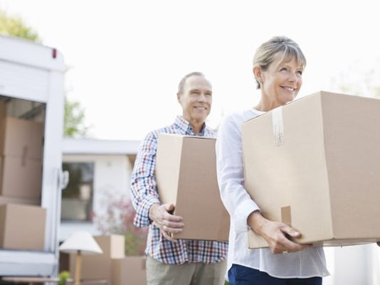 older-couple-unloading-boxes-from-a-moving-van_gettyimages-135385160_large.jpg