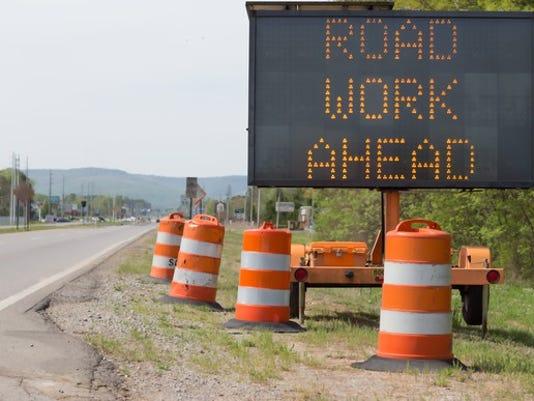 road-work-ahead-sign-on-road_large.jpg