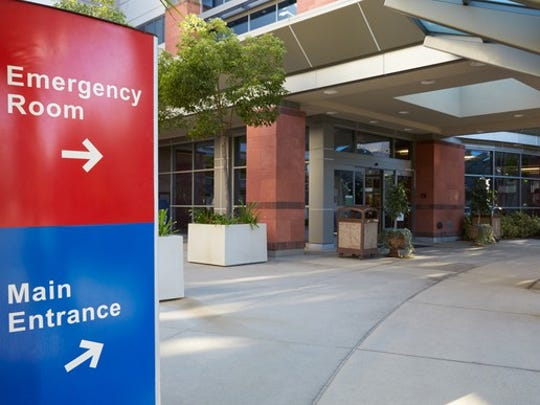 Sign for emergency room and main hospital entrance.