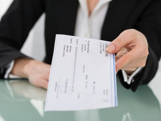 handing-over-a-paycheck_gettyimages-600673276_large.jpg