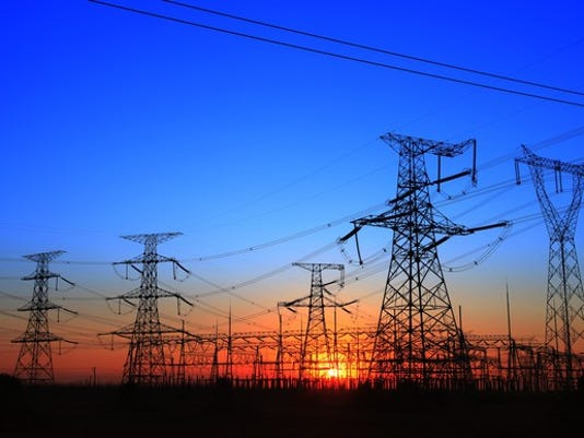 the-silhouette-of-the-evening-electricity-transmission-pylon_large.jpg