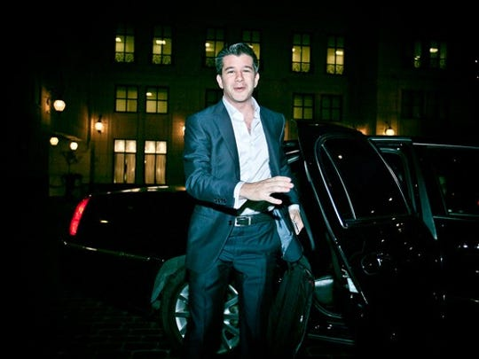 Kalanick is shown exiting a car at night in Chicago.
