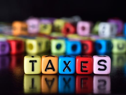 tax-concept-colorful-dice_large.jpg