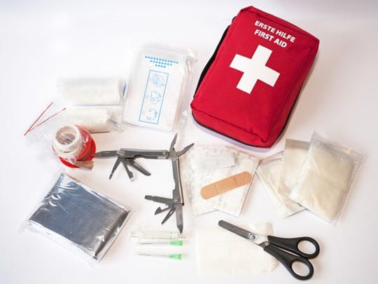 First aid kit with gauze, bandages, gloves, scissors and other medical necessities.