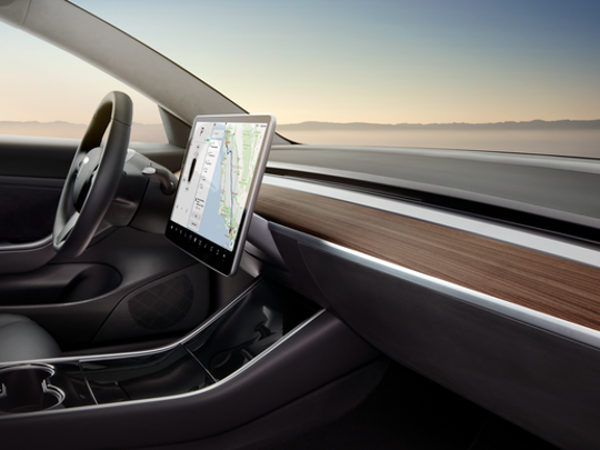 Model 3 front dash and 15-inch touchscreen display.