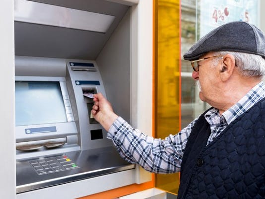 withdrawing-money-getty_large.jpg